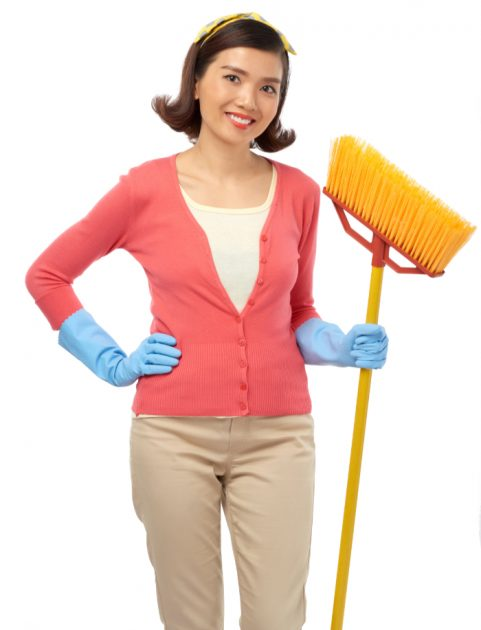 Portrait of cheerful Vietnamese housewife with a mop